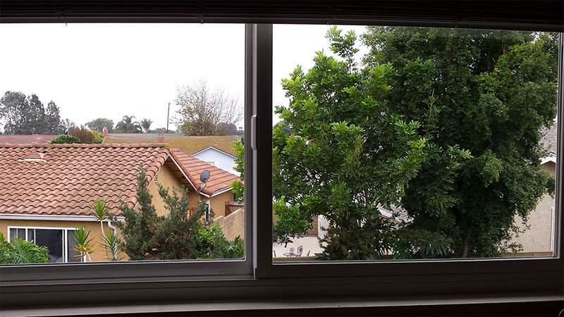 Picture of window before window cleaning in Huntington Beach by Blue Coast Window Cleaning Service.