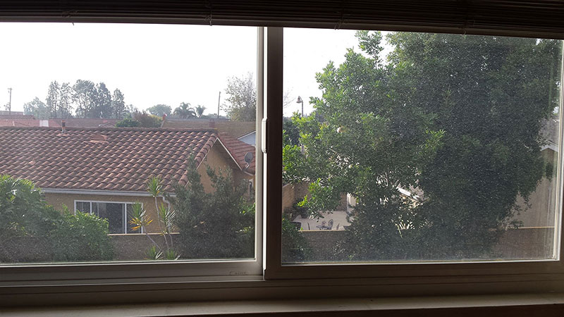 Picture of window before window cleaning in Huntington Beach by Blue Coast Window Cleaning Service