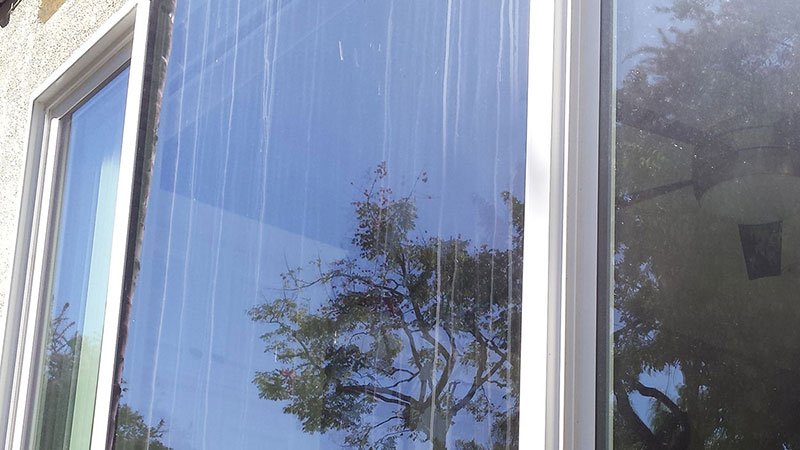 Picture of window before window cleaning in Laguna Niguel by Blue Coast Window Cleaning Service.