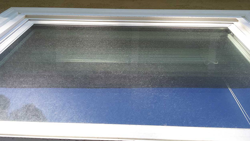Picture of window before window cleaning in Ladera Ranch by Blue Coast Window Cleaning Service.