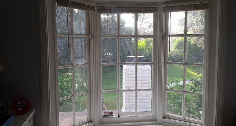 Picture of window before window cleaning in Laguna Beach by Blue Coast Window Cleaning Service.