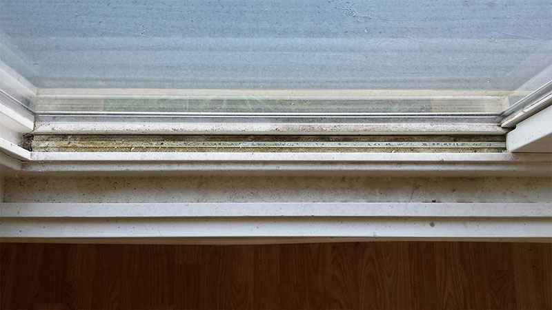 Picture of window track before window cleaning in San Clemente by Blue Coast Window Cleaning Service.