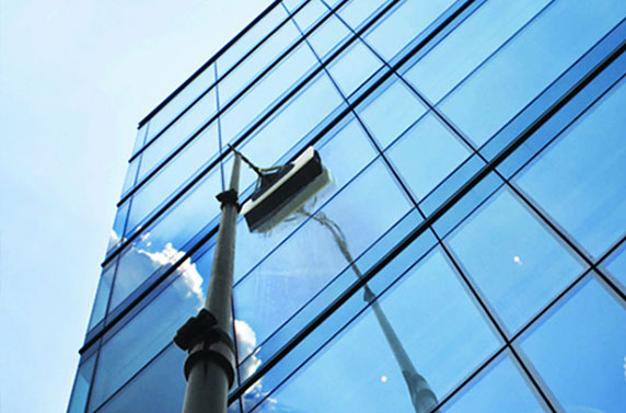 Commercial Window Cleaning with water fed pole by Blue Coast Window Cleaning